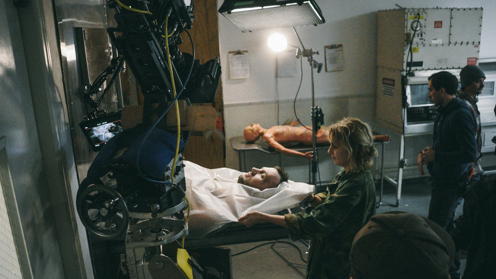 Production Designer Susie Francis adjusts Chris Lake during his cameo setup.