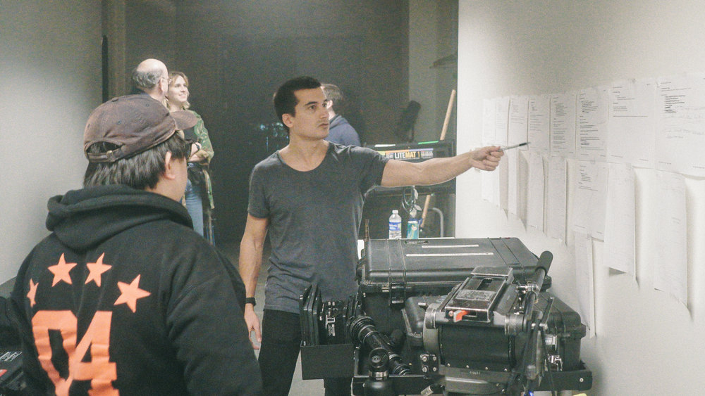 DP Sing Howe Yam looks over schematics with director Norton