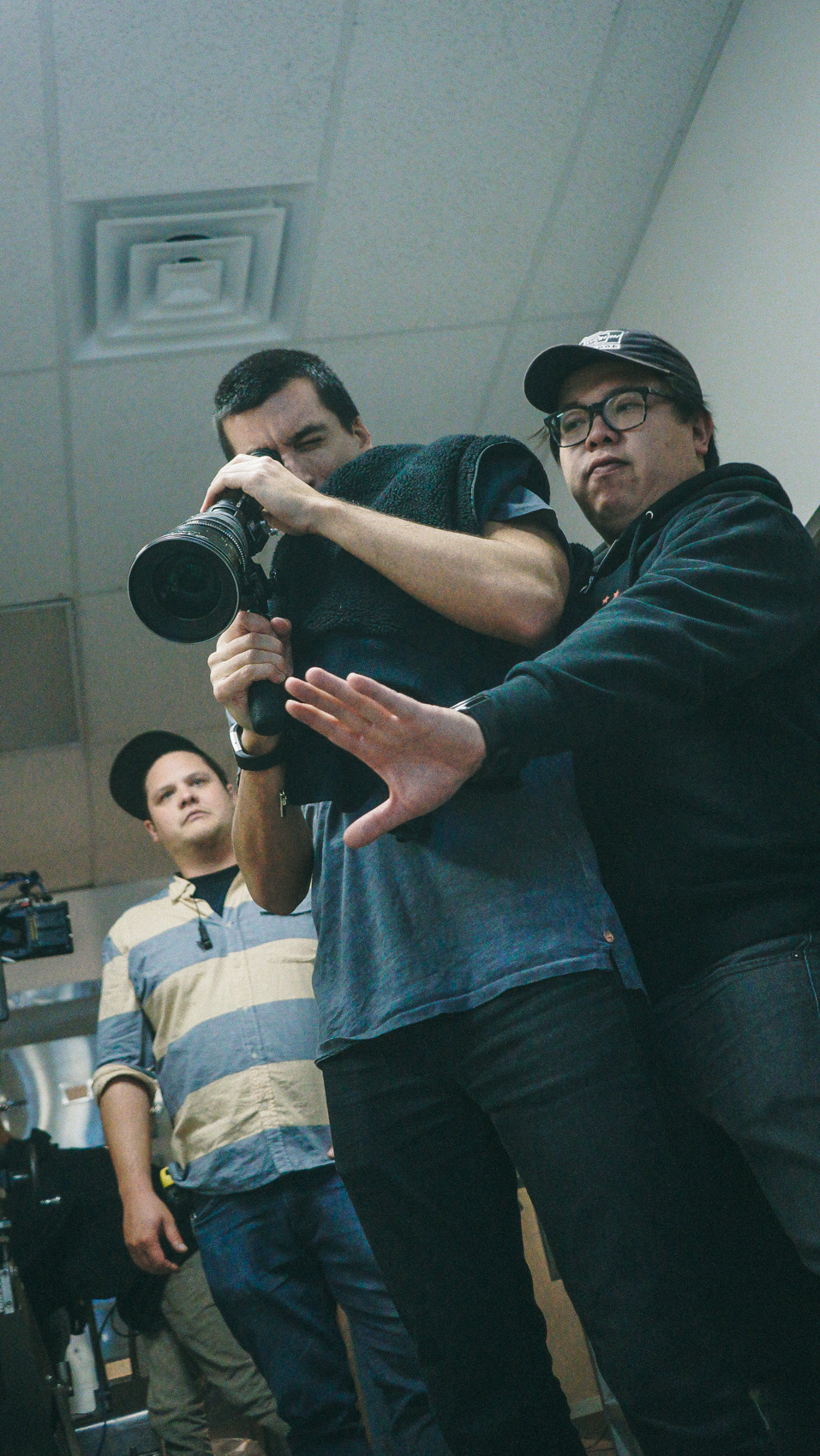 Director Norton (left) and DP Sing Howe Yam (right) discuss a dolly move.