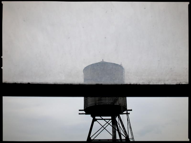 water tower through dirty window.jpg