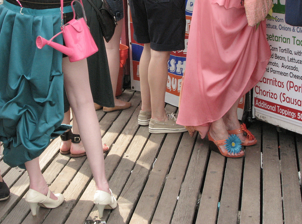 Is there a purse more impractical than one shaped like a pink watering can? Perhaps not. Image is from Coney Island's 2011 Mermaid Parade.