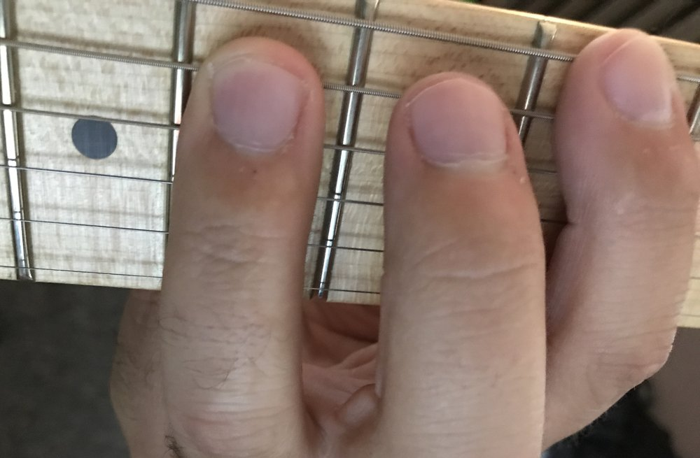 Note: Only my index and ring fingers are down here. My middle finger is not pressing a string.