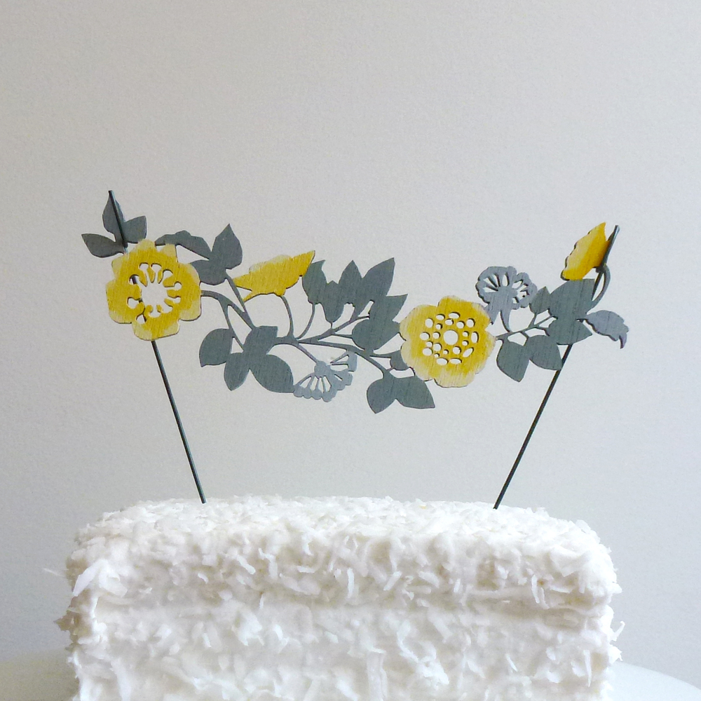 This cake topper has elements of rustic such as the flowers and the way the leaves are but again the execution is clean and refined.