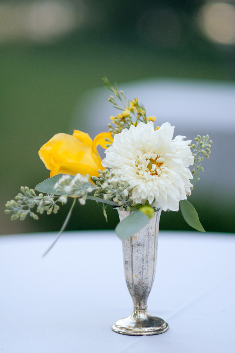 anitque-silver-yellow-white-flower-centerpiece.jpg