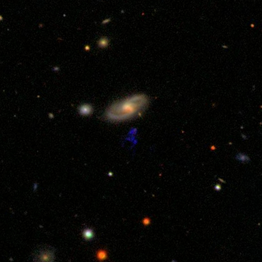 Hanny's Voorwerp is the blue patch below the spiral galaxy. That blue squiggle prompted a worldwide scientific research effort. (Source: Sloan Digital Sky Survey)