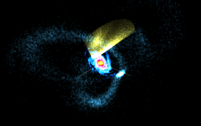 In this visualization of a MilkyWay@home simulation, the bright spiral in the center is the Milky Way. To the right is the Sagittarius Dwarf Elliptical Galaxy with its stream of stars wrapping around the Milky Way. The yellow fan represents the observed data from the Sloan Digital Sky Survey.  Credit: Shane Reilly, MilkyWay@home