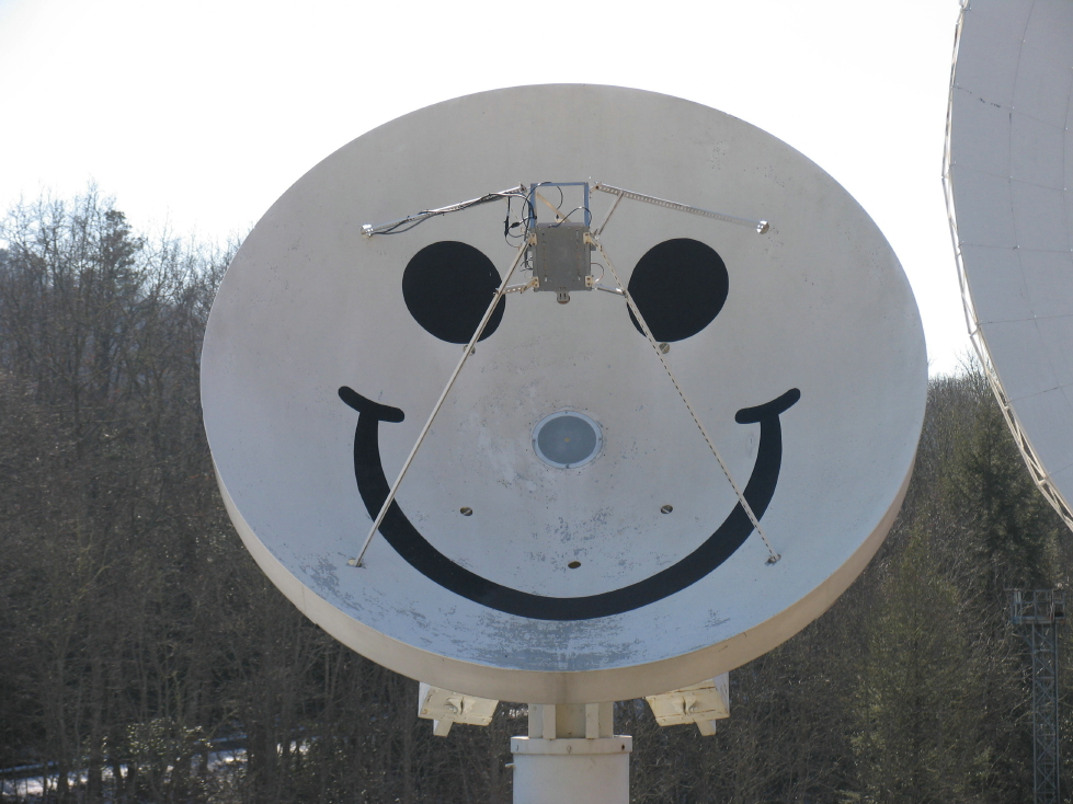 "The 4.6-meter radio dish got its smile during the Cold War when it was part of a National Security Agency intelligence station. The station's operators pointed Smiley upwards whenever a Soviet spy satellite passed overhead - just to say ""hi!""  Credit:  Pisgah Astronomical Research Institute"
