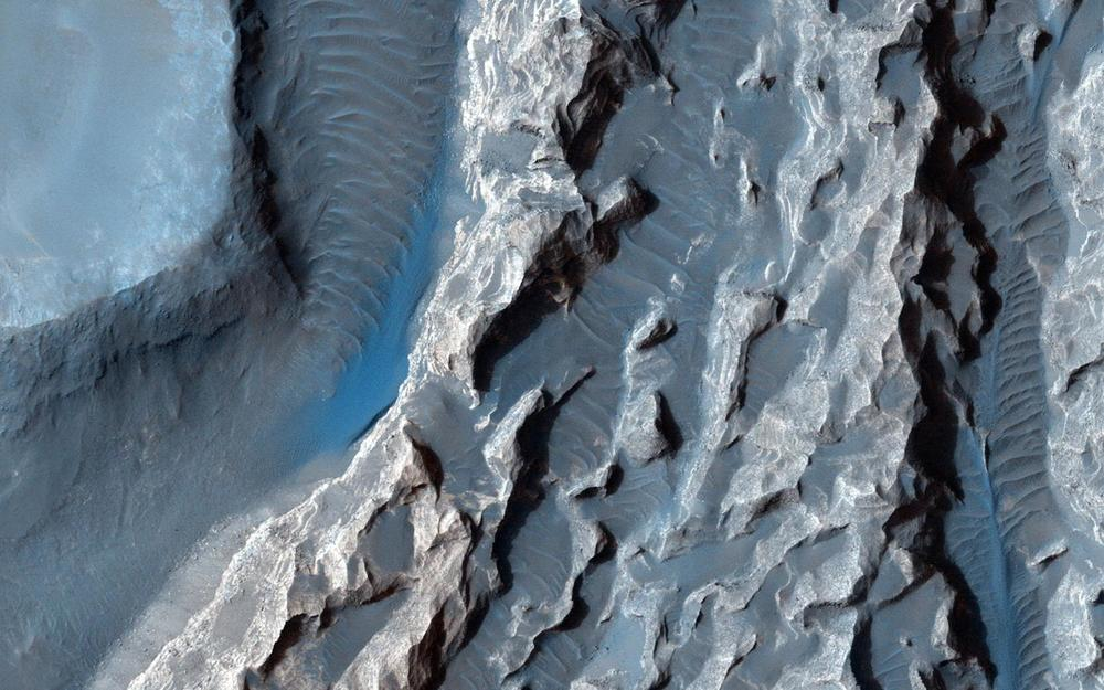 Who among the 663 Mars One candidates will be first to go here? A detail of the chaos region in Valles Marinaris taken by the Mars Reconnaissance Orbiter.  Credit:    NASA/JPL-Caltech/Univ. of Arizona