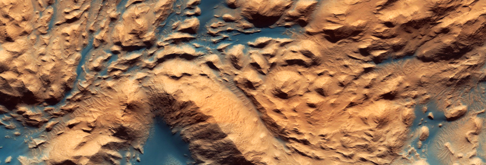 This image from the HiRise camera on the Mars Reconnaissance Orbiter shows how winds have carved channels and formed dunes in the equatorial Medusae Fossae region at the border between the northern lowlands and southern highlands. (Click on the image to see it full size or follow the link for the original HiRise image) Source: Nasa/JPL/University of Arizona