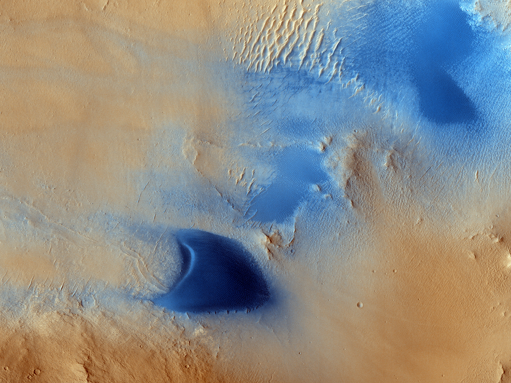 The HiRise team released this image of sand dunes in the Arabia Terra region of Mars. The colors are enhanced to show the drifiting sands in blue. (Click the image to see it full-sized or follow the link for more details) Credit: Nasa/JPL/University of Arizona