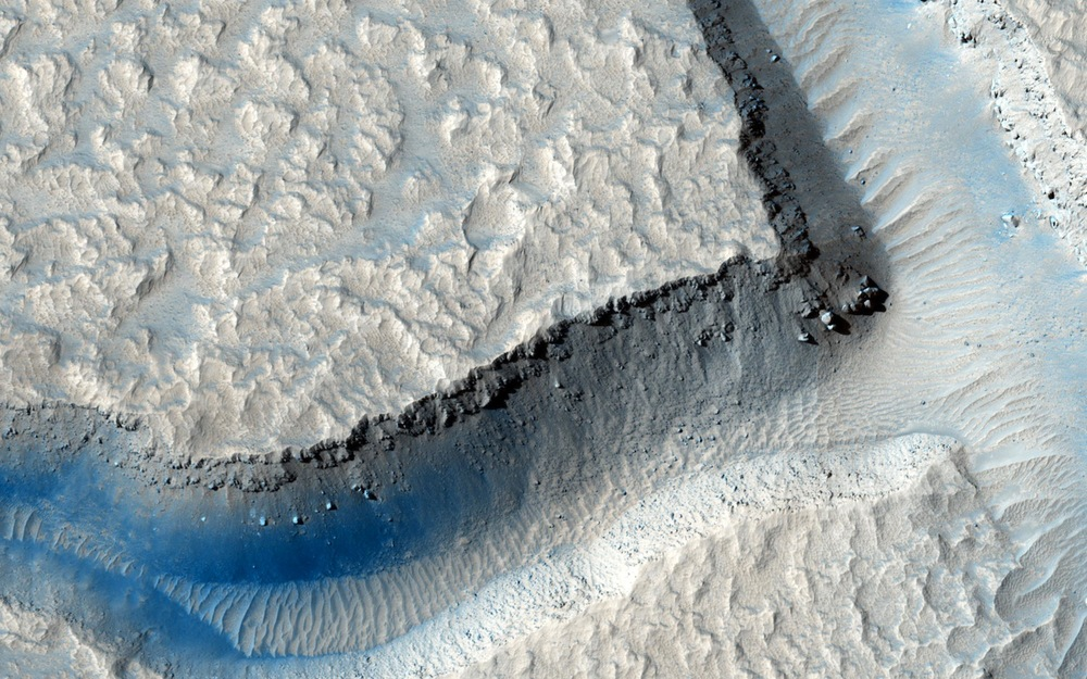 This image  taken by the Mars Reconnaissance Orbiter's HiRise camera shows Echus Chasma which  may have been the water source that formed the Kasei Valles region of Mars. Thoth Technology will let you vote to send its mini rover to explore Kasei Valles.  (Click on the image to see it full size or follow the link for more information about the image)   Credit:  Nasa/JPL-Caltech/Univ. of Arizona