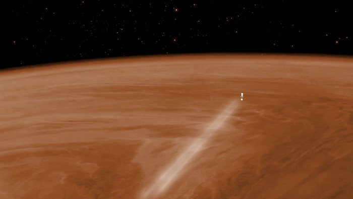 An artist's concept of Venus Express passing through the planet's atmosphere. Credit: Esa, C. Carreau