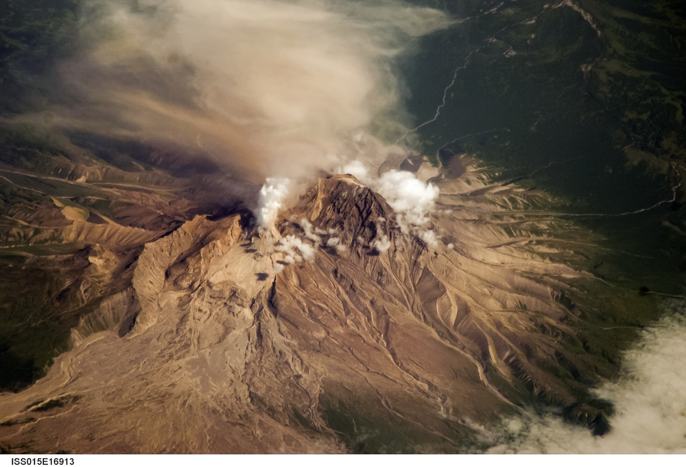 Astronaut's-eye view of an erupting volcano.  Source:  Nasa/JSC-Earth Science and Remote Sensing Unit
