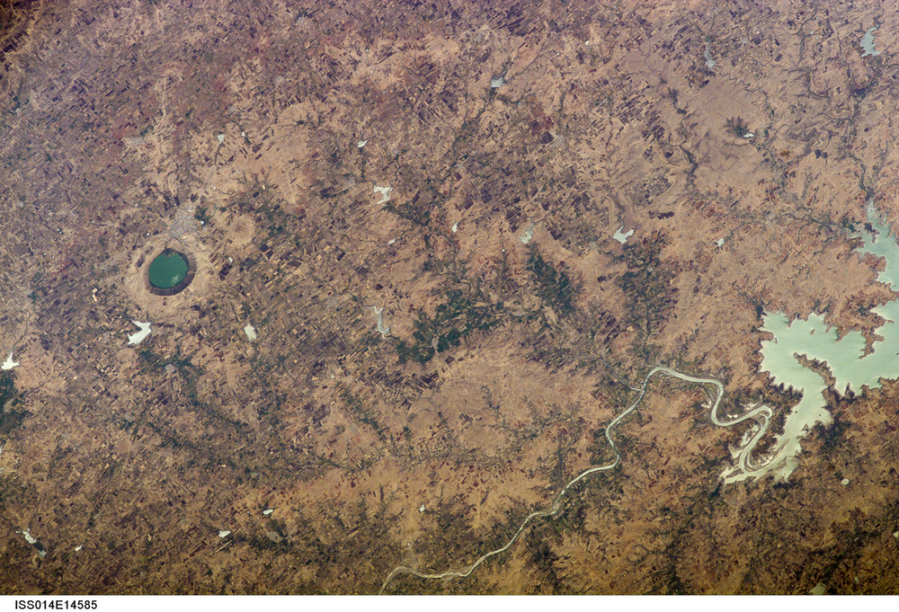 Earth's unique combination of water and life often mask impact craters. Lonar Lake is a water-filled impact crater in India's Mahrashtra state.  ( Source )