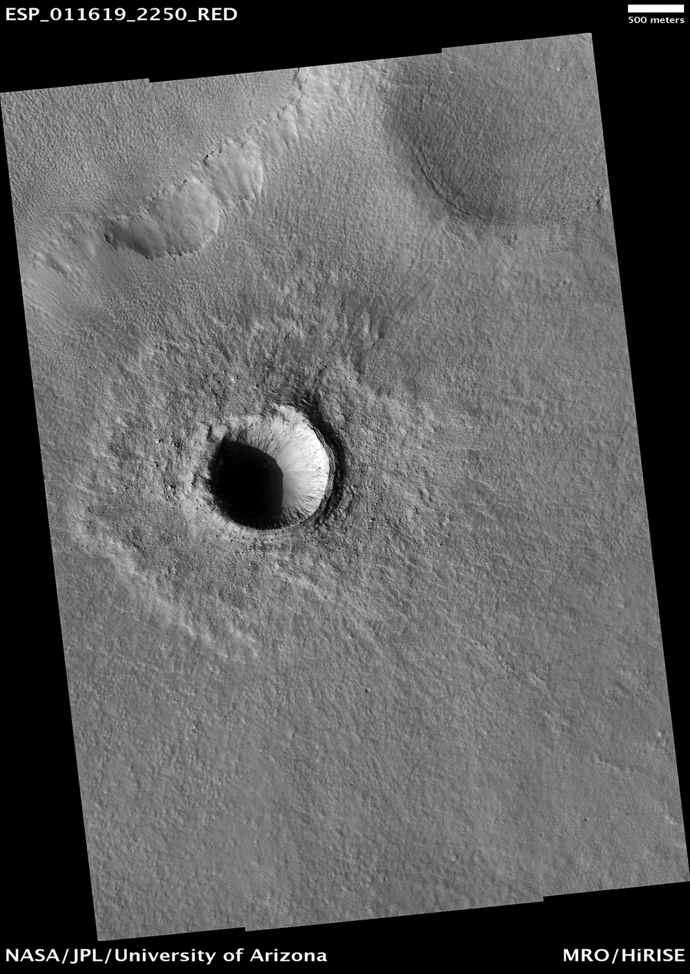 Asteroid impacts still happen. This kilometer-wide crater formed sometime after the Mars Reconnaissance Orbiter arrived at Mars.  ( Source )