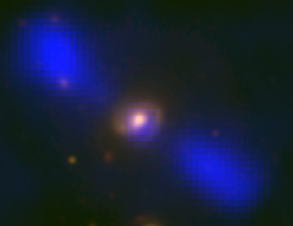 Galaxy J1649+2635 in two spectra. The blue blobs are radio signals produced by jets pour out of the galactic core. The spiral yellow is visible light of the galaxy itself. Source:  Mao et al., NRAO/AUI/NSF, Sloan Digital Sky Survey