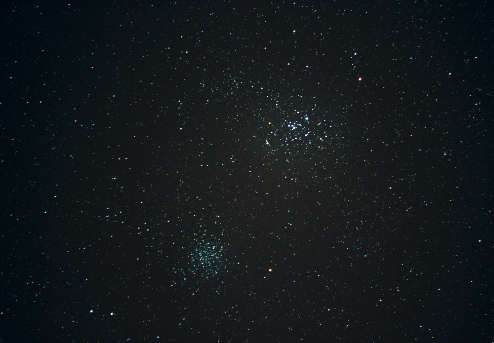 Two star clusters from my balcony. Messier 46 is the fainter cluster in the lower center. Messier 47 is the brighter cluster in the upper center. Credit: Chris Casper