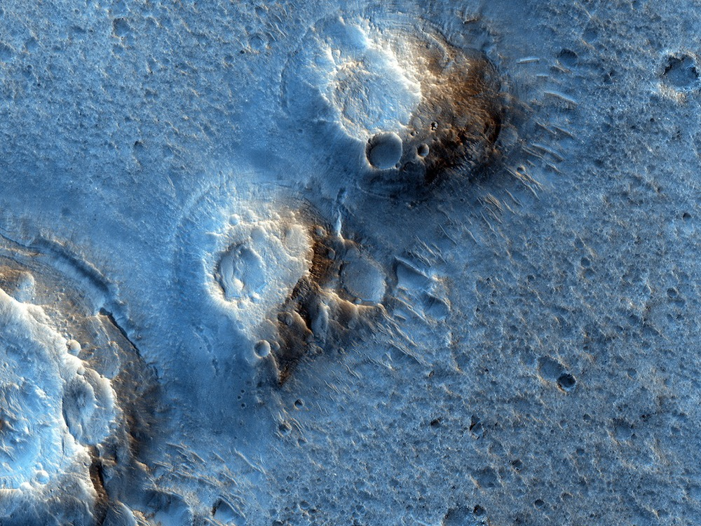 The view of Acidalia Plantia from the Mars Reconnaissance Orbiter's HiRise camera shows mounds created by lava-water interaction or mud eruptions. Credit:  Nasa/JPL-Caltech