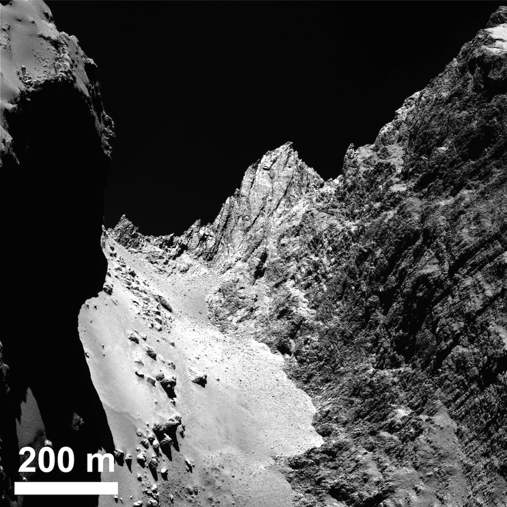 The Cliffs of Hathor (I love saying that). Rosetta's ability to send amazingly detailed images like this to Earth also means it can't see what's happening on a larger scale. The Rosetta mission has asked amateurs to help track the big picture while Rosetta (and with luck Philae) does its thing. Credit: Esa/Rosetta/MPS for Osiris Team MPS/UPD/LAM/IAA/SSO/INTA/UPM/DASP/IDA