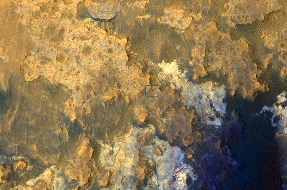 The Mars Reconnaissance Orbiter snapped this picture of Curiosity (in the blue box at center) roving through a valley on the slopes of Mount Sharp. Credit: Nasa/JPL-Caltech/University of Arizona