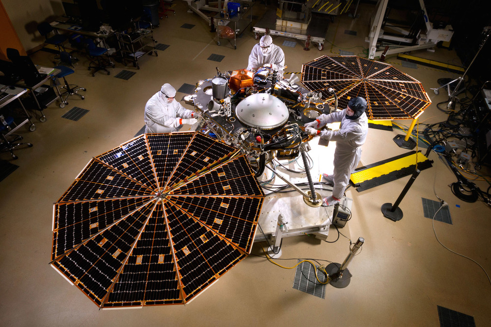 The great thing about being a Lockheed Martinengineer? Mood lighting. Based on a platform developed for the successful Pheonix mission,Nasa's Insight mission will explore the interior of Mars.Credit: Nasa/JPL-Caltech/Lockheed Martin
