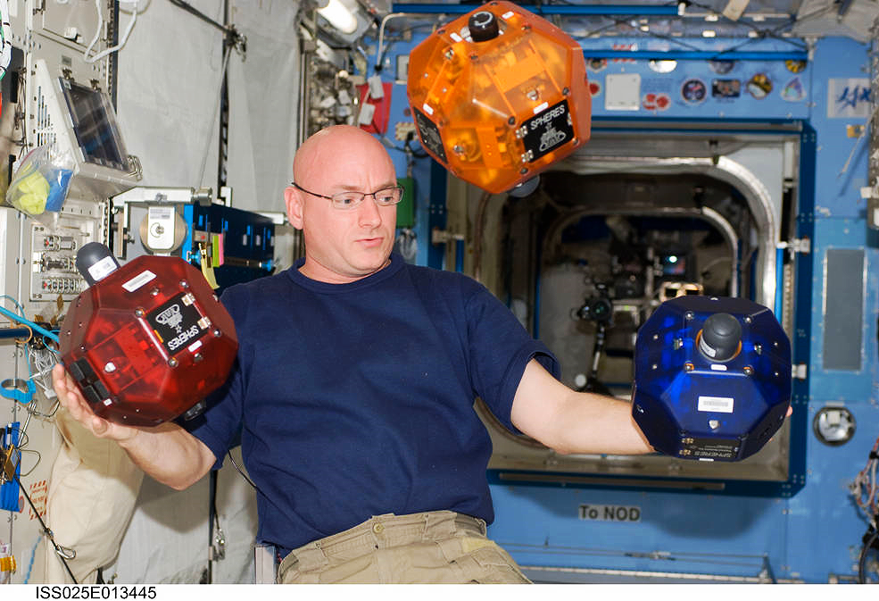 Nasa astronaut Scott Kelly with the Spheres robots during his 2010 stay on the International Space Station. Designed to test spacecraft control software in zero gravity, the Spheres project also lets students apply their programming skills in space.  Credit:  Nasa