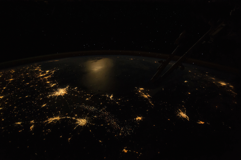A moonlit Gulf of Mexico is surrounded by Texas city lights as seen from the International Space Station (ISS042-E-241898)  Credit:  Nasa/Johnson Space Center/Earth Science and Remote Sensing Unit