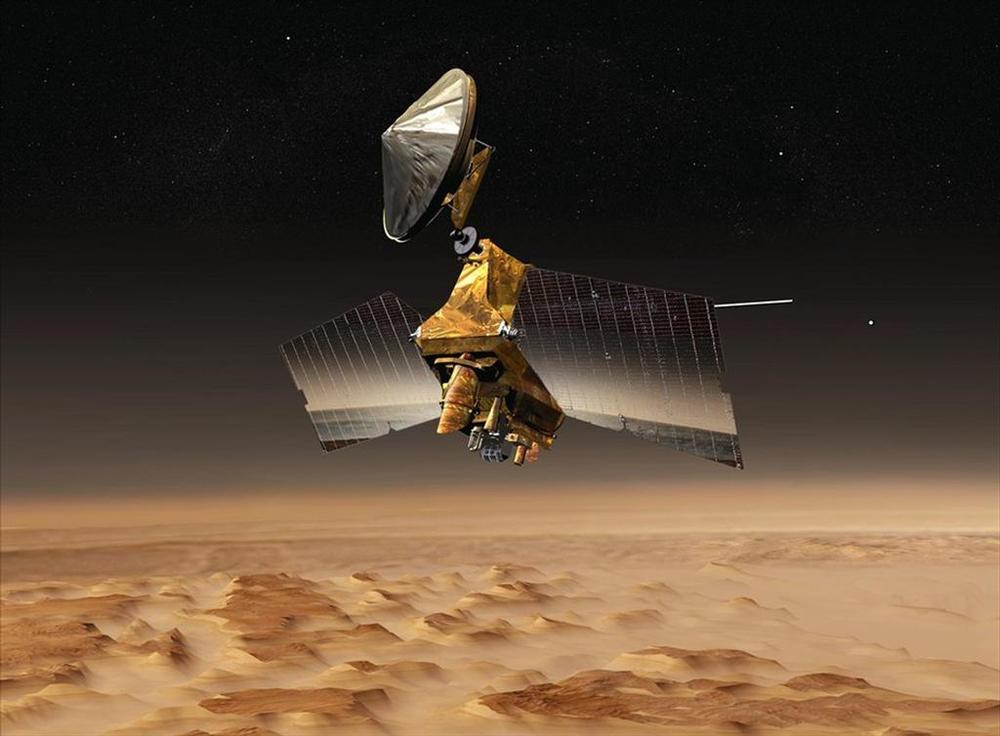An artist's concept of the Mars Reconnaissance Orbiter over the red planet.  Credit:  Nasa/JPL-Caltech