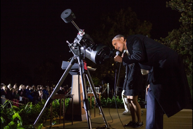President Barack Obama at the White House Astronomy Night. While he may not have seen much with the floodlights shining into the telescope, the President honored many budding scientists and engineers.  Credit:  Official White House photo by Pete Souza