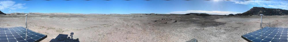 No, this isn't Mars. The Canadian Space Agency took this panorama with its Mars Exploration Science Rover in the Utah desert. A team of Canadian students is learning how to conduct a planetary mission by directing the rover's operations.  Credit:  Canadian Space Agency