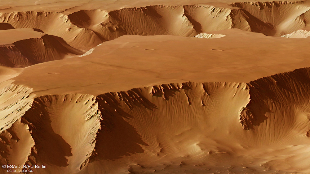 IMG A perspective view of Noctis Labyrinthus from Esa's Mars Express orbiter. The fractured landscape formed as the volcanic Tharsis region bulged billions of years ago.  Credit:  Esa/DLR/FU Berlin, CC BY-SA 3.0 IGO