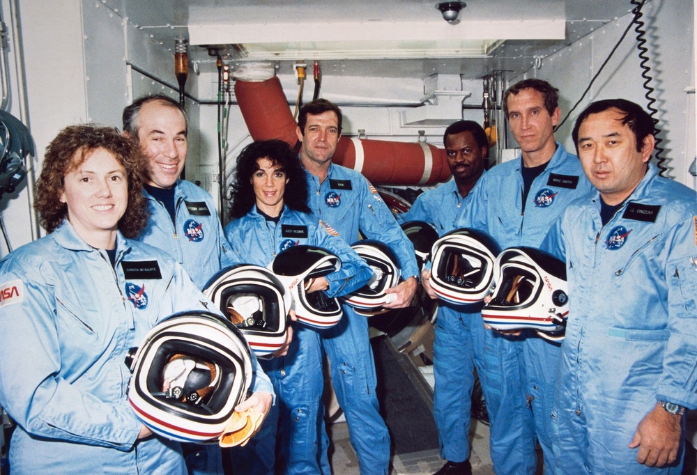 Payload Specialist and teacher Christa McAuliffe (far left) and her crewmates on STS-51L: Payload Specialist Gregory B. Jarvis, Mission Specialist Judith A. Resnik, Commander Francis R. Scobee, Mission Specialist Ronald E. McNair, Pilot Michael J. Smith, Mission Specialist Ellison S. Onizuka.  Credit:  Nasa