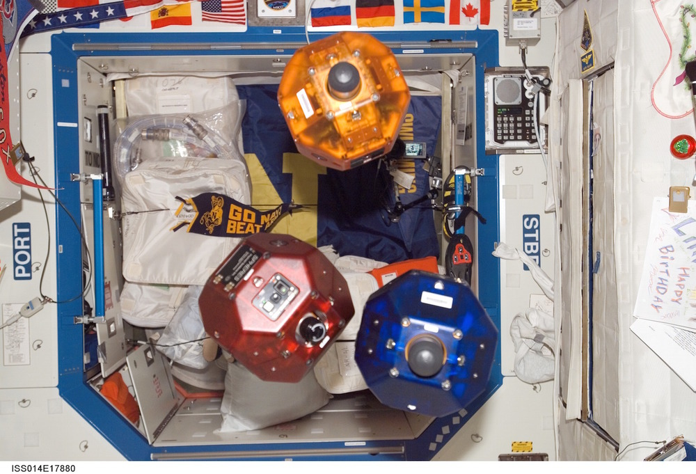 MIT developed the Spheres robots to test spacecraft maneuvering and control. Powered by jets of carbon dioxide gas, the robots zip inside the International Space Station. The 2015 Zero Robotics High School Tournament let students around the world control the robots. Credit: Nasa