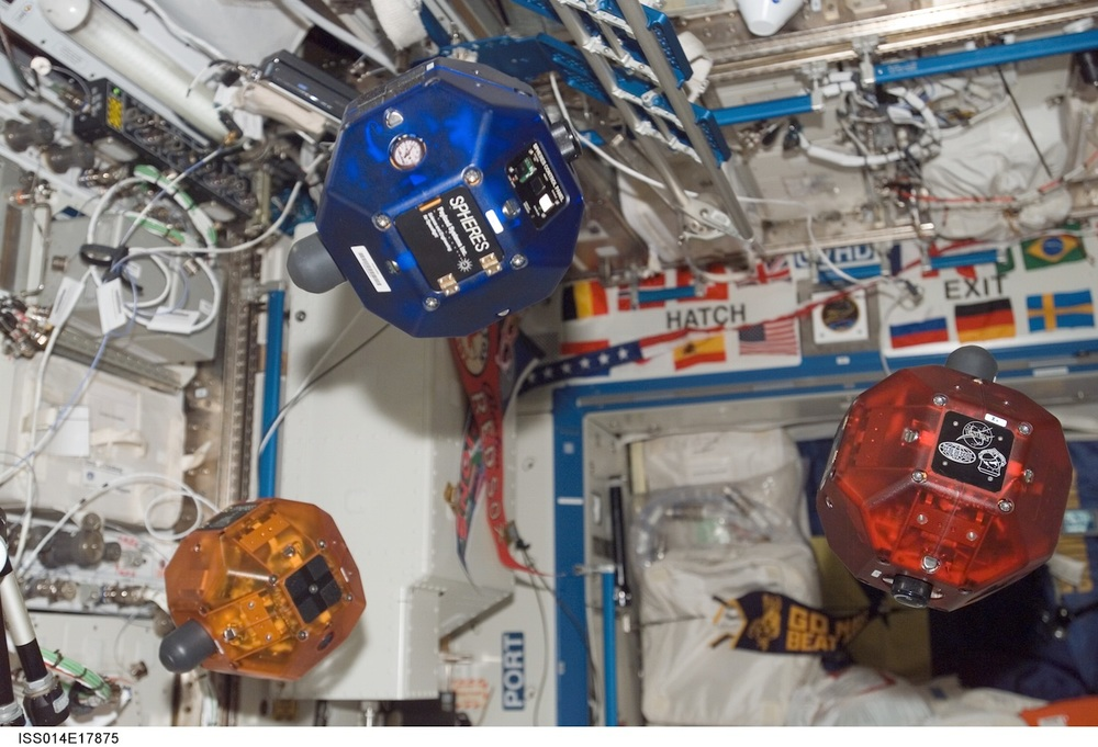 The MIT-developed Spheres robots use jets of compressed air to move around the International Space Station. Kids around the world learn how to control the Spheres in the Zero Robotics programming competition.  Credit: Nasa