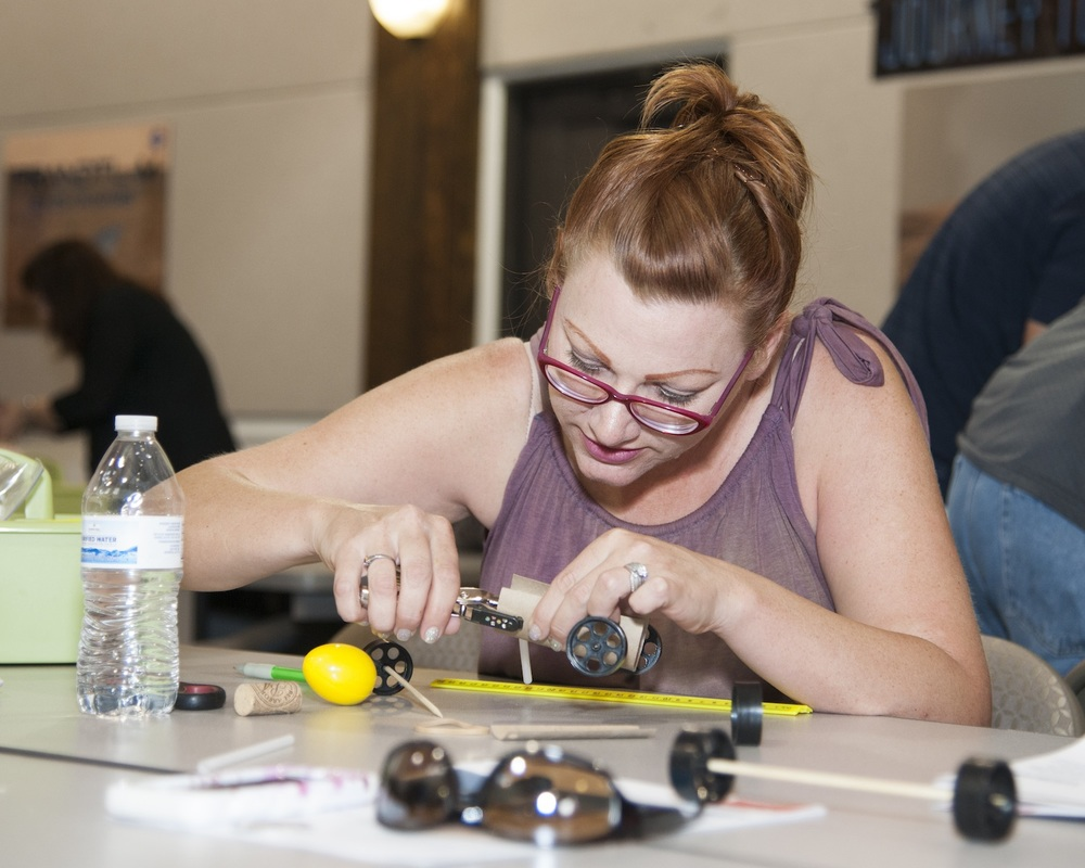 "An educator learns how a ""rover"" build can enhance science classes.  Credit:  NASA Photo/Lauren Hughes"