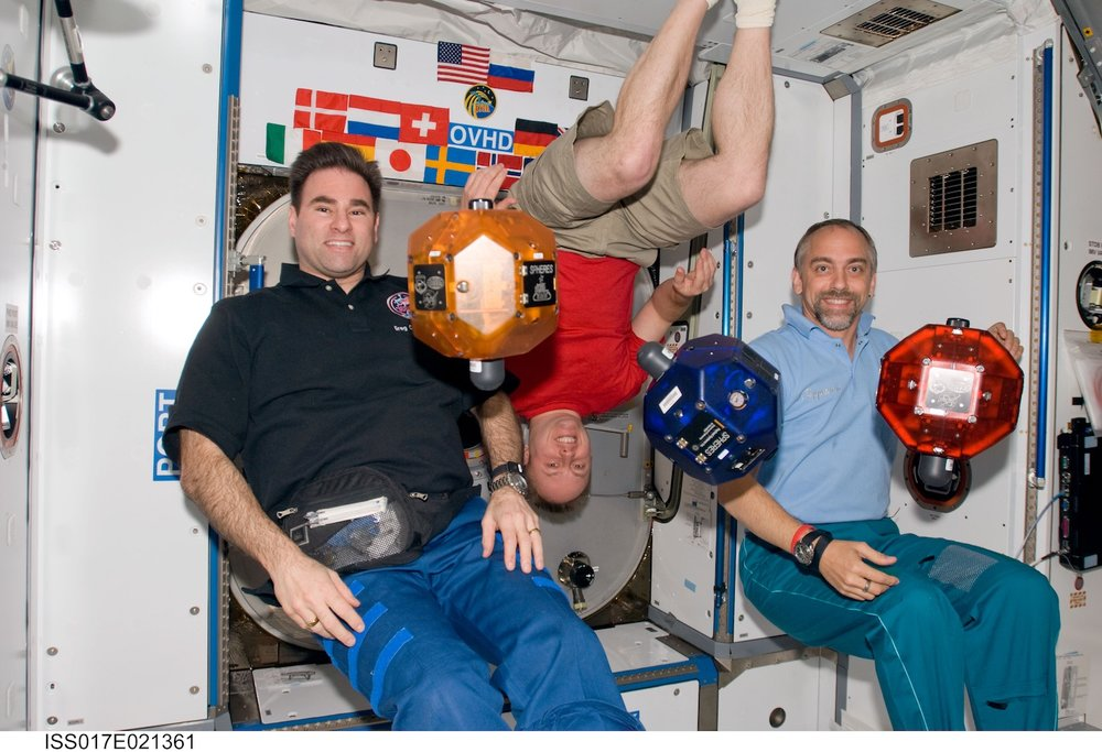 Astronauts pose with the Spheres robots on the International Space Station. Credit: Nasa