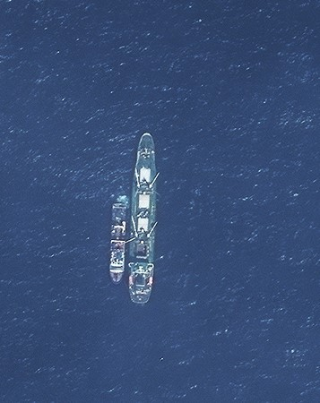 "Fish pirates do the equivalent of money laundering by handing their illegal catch to ""reefers"". These refrigerated ships mix the catch with fish caught legally so the cannot be traced.  Credit: Digital Globe"