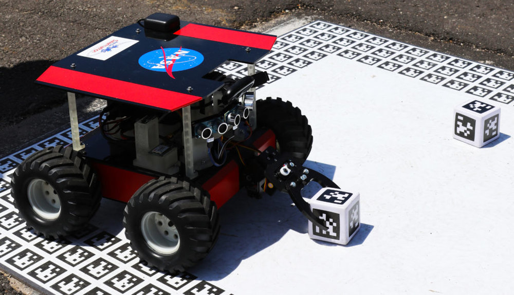 "Swarmathon competitors had to program a dozen robots like this one to collect ""samples"". Future exploration missions may use many small rovers rather than one big rover. Credit: Nasa/ KSC"