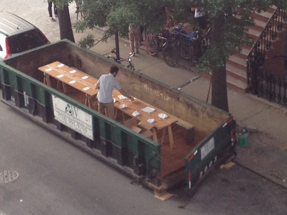 The aerial view of the Salvage Supperclub taken from an NSA government drone - Josh Treuhaft setting the table that he made earlier in the day along with the benches for seating....