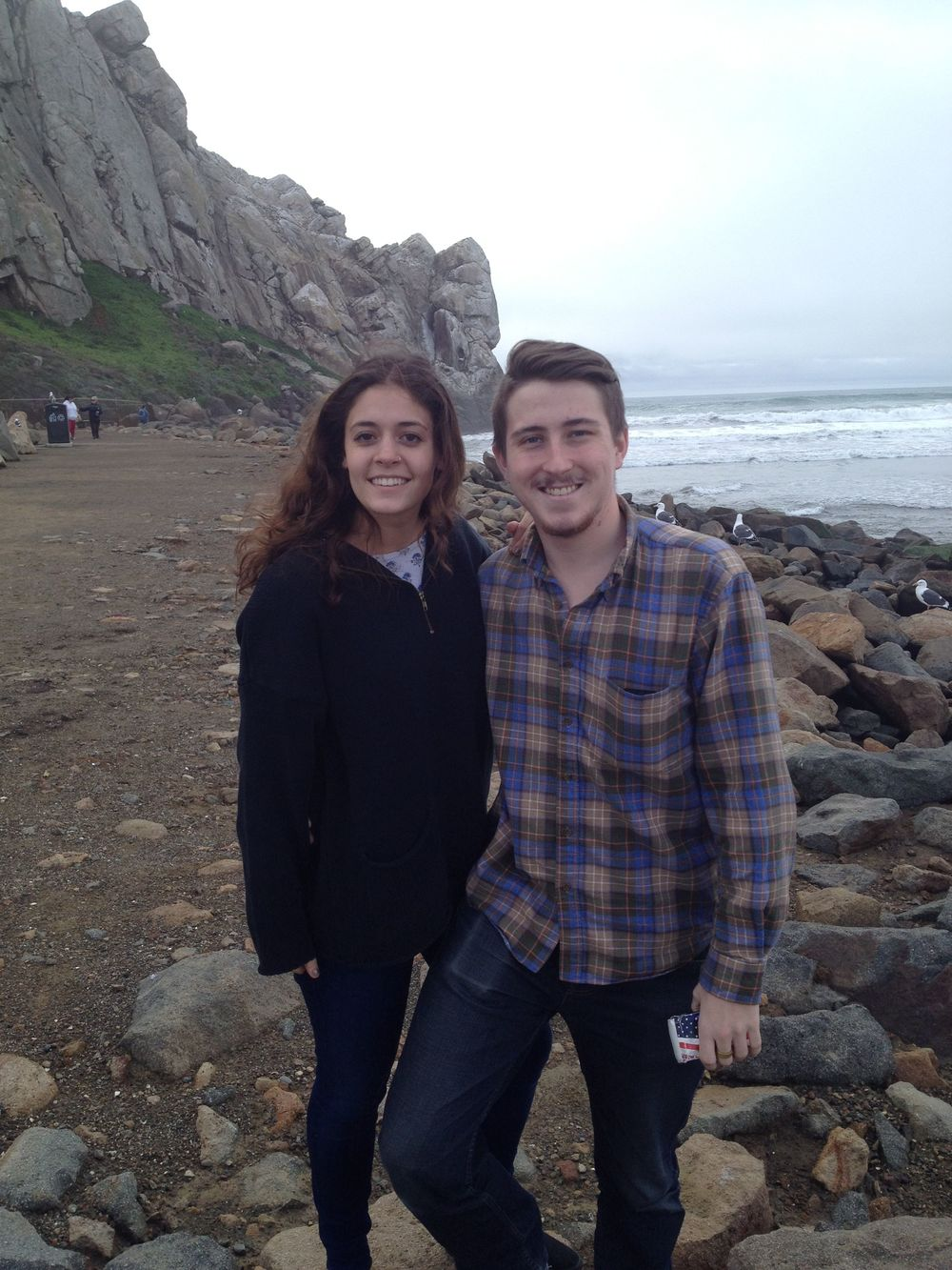 Siena and Cooper at Morro Bay, California with the edge of Morro Rock in the background.