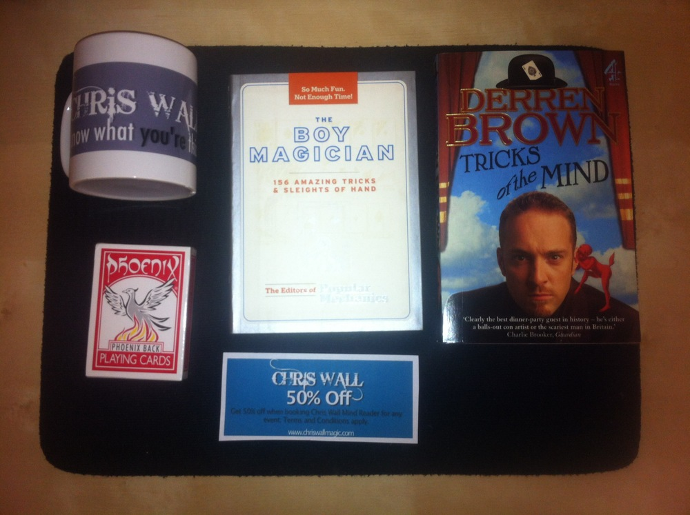 The prize for the sweepstakes.   You could win.   1) 1x Chris Wall Magic Limited Edition Mug  2) 1x 50% off Voucher  3) 1x Derren Brown 'Tricks of the Mind' book  4) 1x Beginner Magicians Book.  5) 1x New deck of playing cards.