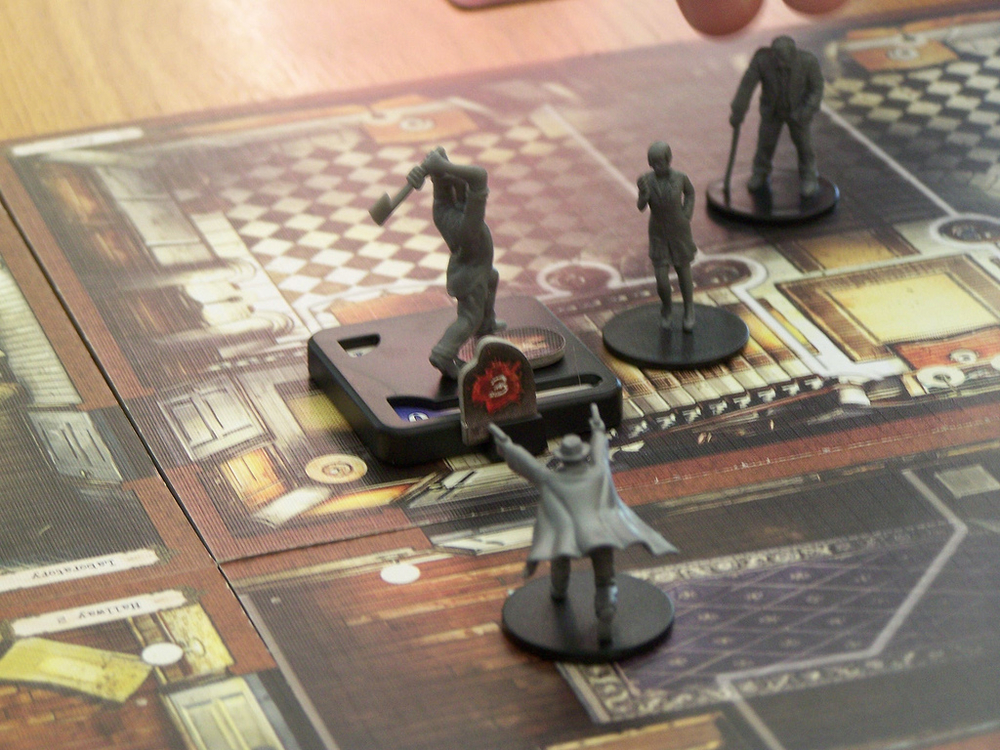 Mansions of Madness - an example of a boardgame featuring competition and cooperation.