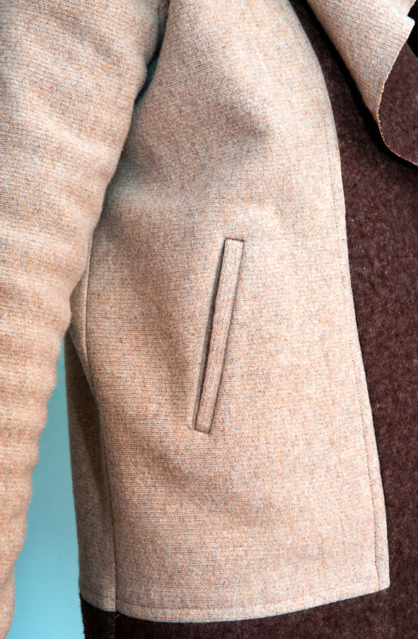 Jacket details: welt pocket, top stitched mock flat-felled seams, fleece-backed ribbed wool sweater knit fabric.