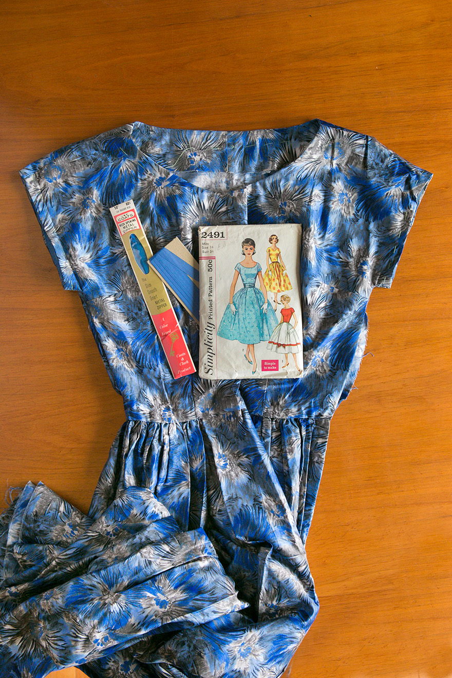 vintage Simplicity pattern 2491, printed cotton sateen fabric dress, bodice and facings sewn, skirt basted to bodice, zipper still new in packaging, waiting to be installed in the side seam