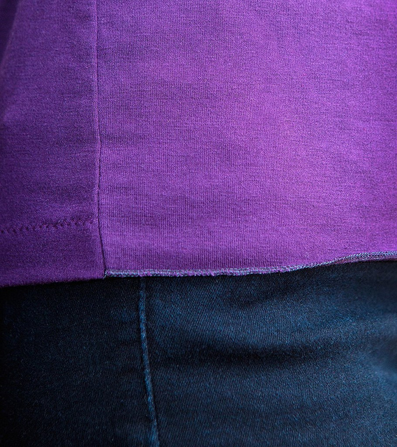 Back hemmed edge meets overlocked front flounce at side seam
