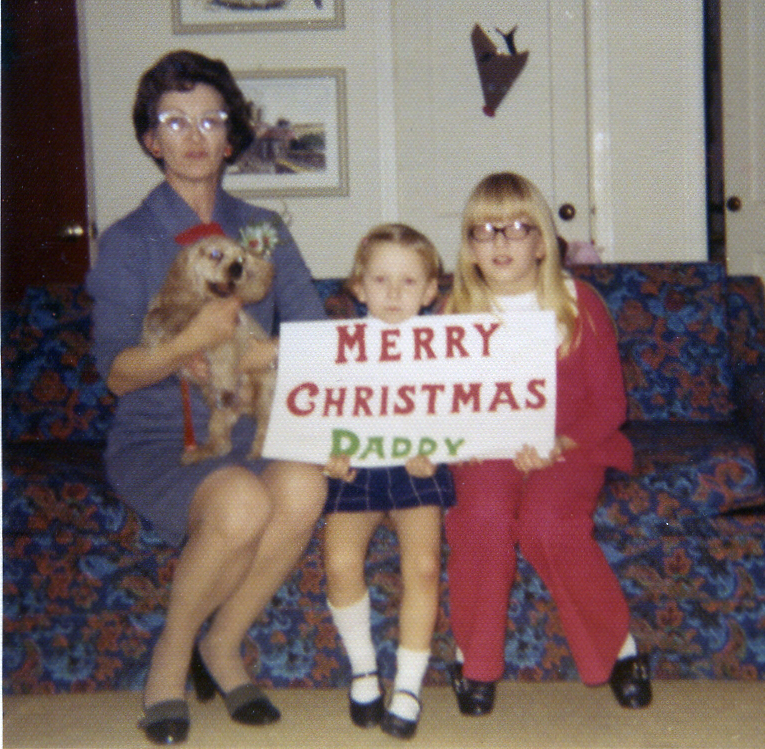 Photo of My mom, our new puppy, myself (age 4) and my sister taken by friends while at their house for Christmas dinner. At the time, my father was away for about six months on the  USS Little Rock  in the Mediterranean.