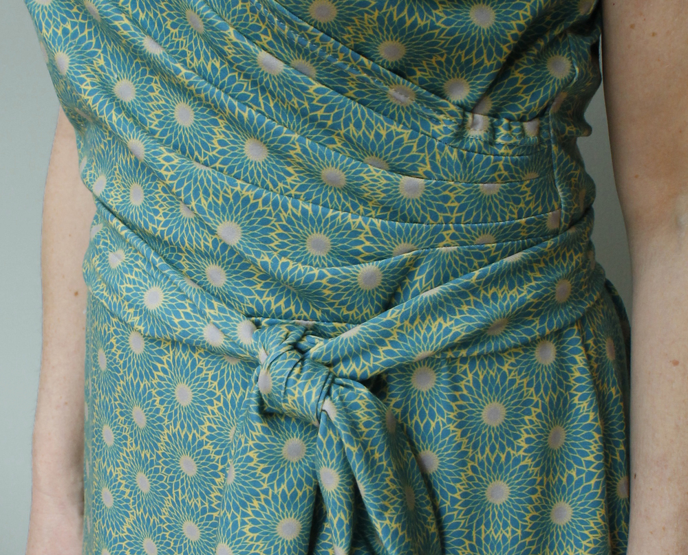 Detail of pleated front wrap and tie.