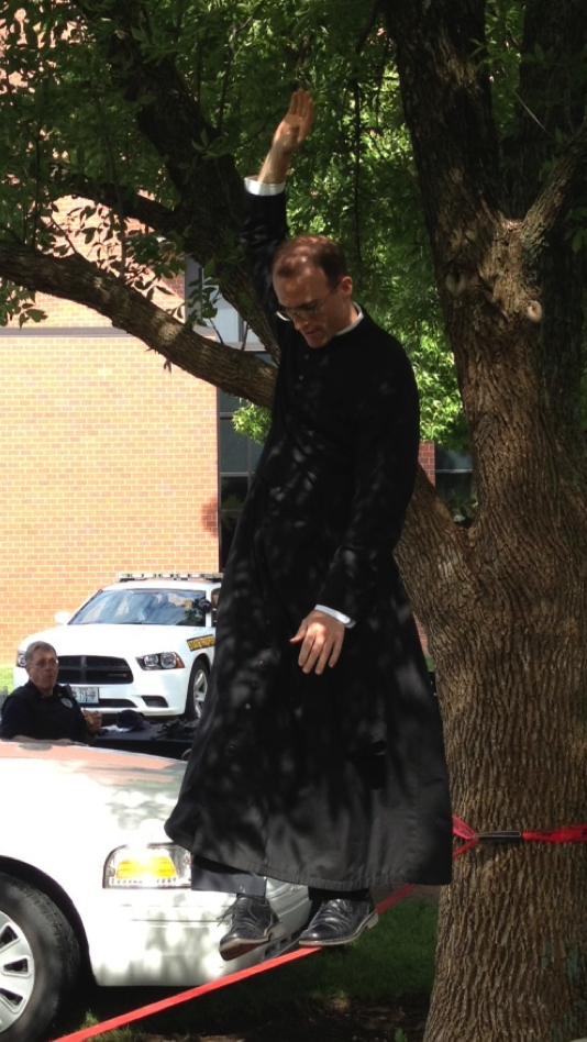 It's not every day you see a priest slacklining!