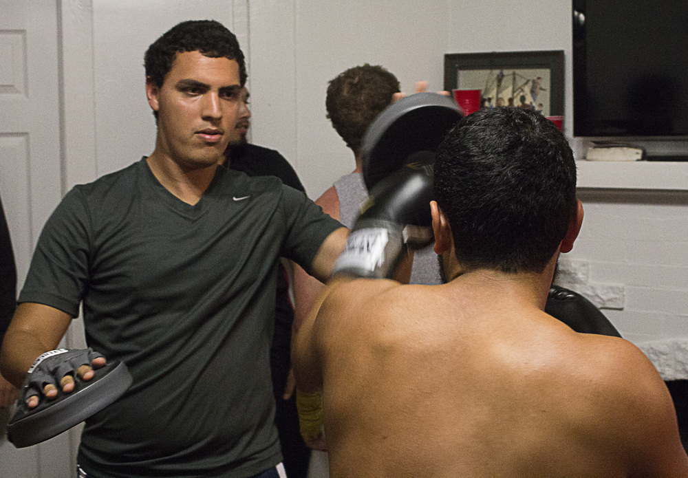 Fighters warmed up by throwing punch combinations with partners.