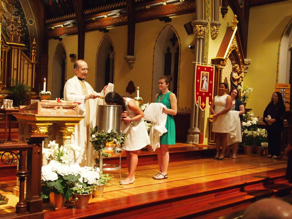 Holli receiving the Sacrament of Baptism